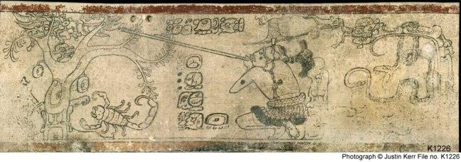 Wuqub' Kaqi'x está sobre el árbol, a la izquierda. Xb'alamq'eh está escondido detrás del tronco, con solo su mano como de garra de jaguar mostrándose justo debajo de la fruta que cuelga de la base de la rama derecha del árbol. Junajpu, apuntando con su cerbatana, se agacha a la derecha y está cubierto por un sombrero de paja. De un vaso maya del período Clásico.